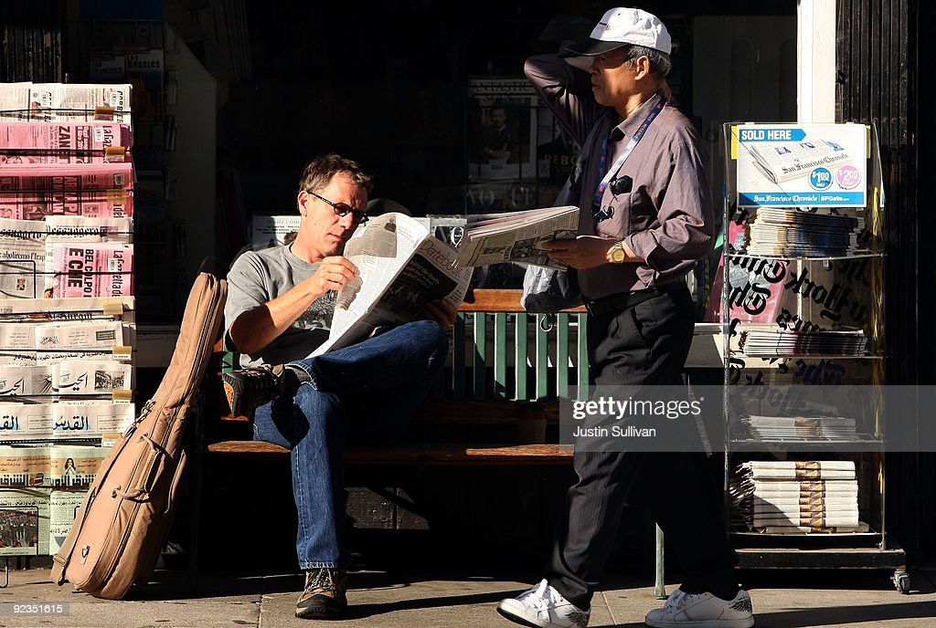 Brian Keeney (L) reads the San Francisco Chronicle as he sits on a bench in front of a newsstand October 26, 2009 in San Francisco, California. A report by the Audit Bureau of Circulations reveals that the average daily circulation of U.S. newspapers fell 10.6 percent in the six month period between April-September compared to one year ago. The San Francisco Chronicle had the largest decline with a drop of 25.8 percent to 251,782. The Wall Street Journal surpassed USA Today as the number one selling paper in the U.S. after USA Today had its circulation drop more than 17 percent to 1.90 million.