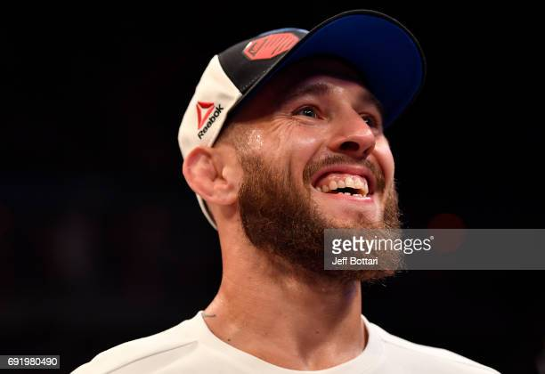 Brian Kelleher celebrates after his submission victory over Iuri Alcantara of Brazil in their bantamweight bout during the UFC 212 event at Jeunesse...