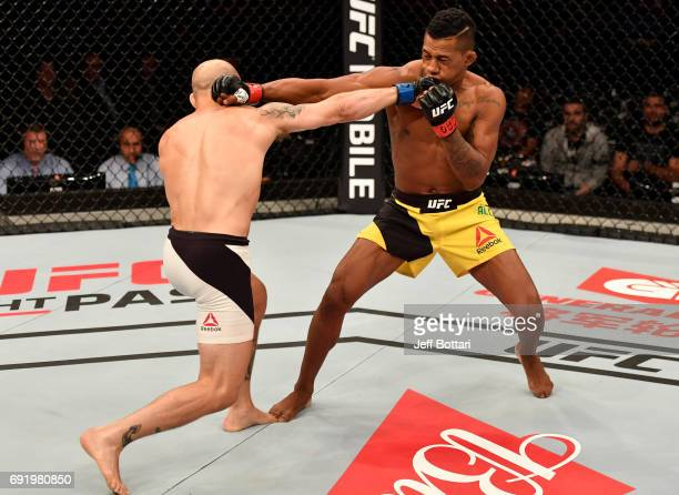 Brian Kelleher punches Iuri Alcantara of Brazil in their bantamweight bout during the UFC 212 event at Jeunesse Arena on June 3 2017 in Rio de...