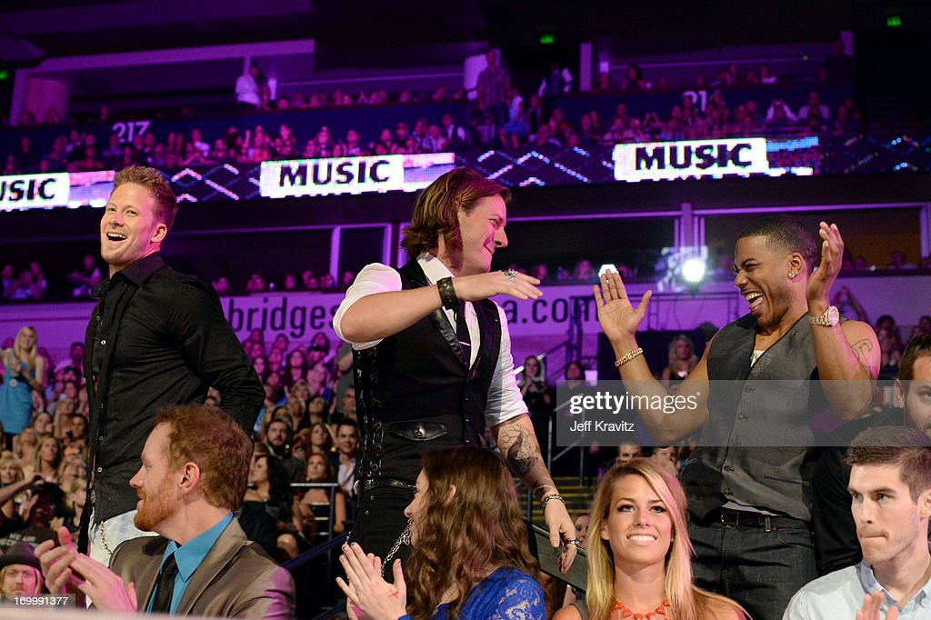 Brian Kelley and <a gi-track='captionPersonalityLinkClicked' href=/galleries/search?phrase=Tyler+Hubbard&family=editorial&specificpeople=9453787 ng-click='$event.stopPropagation()'>Tyler Hubbard</a> of Florida Georgia Line and Nelly attend the 2013 CMT Music Awards at the Bridgestone Arena on June 5, 2013 in Nashville, Tennessee.