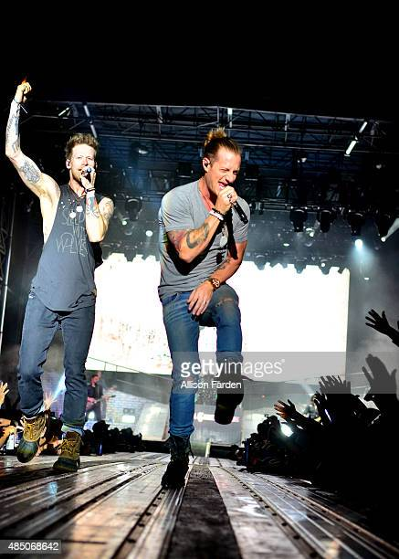 Brian Kelley and Tyler Hubbard of Florida Georgia Line perform at Texas Thunder on August 23 2015 in Gardendale Texas