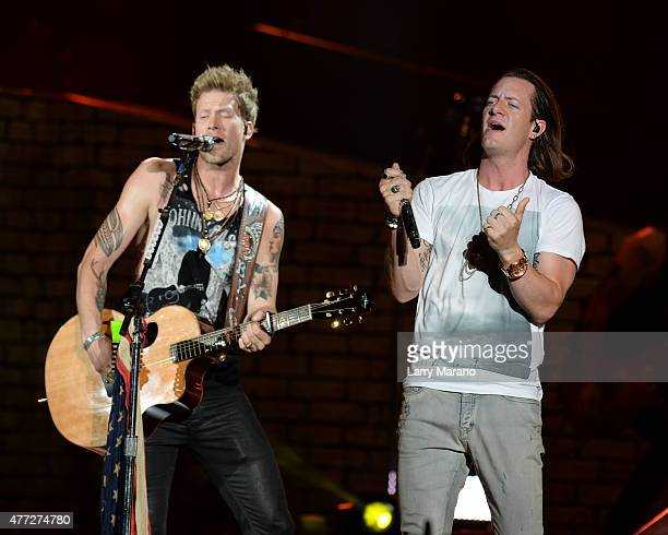 Brian Kelley and Tyler Hubbard of Florida Georgia Line perform at the Coral Sky Ampitheatre on May 28 2015 in West Palm Beach Florida