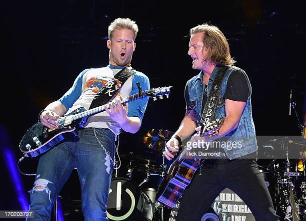 Brian Kelley and Tyler Hubbard of Florida Georgia Line perform during the 2013 CMA Music Festival on June 8 2013 at LP Field in Nashville Tennessee