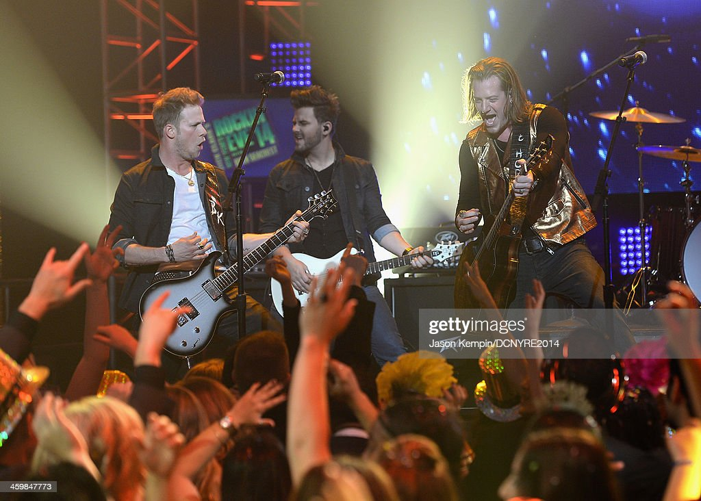 Brian Kelley and <a gi-track='captionPersonalityLinkClicked' href=/galleries/search?phrase=Tyler+Hubbard&family=editorial&specificpeople=9453787 ng-click='$event.stopPropagation()'>Tyler Hubbard</a> of Florida Georgia Line perform during Dick Clark's New Year's Rockin' Eve with Ryan Seacrest 2014 at Sunset Gower Studios on December 31, 2013 in Los Angeles, California.