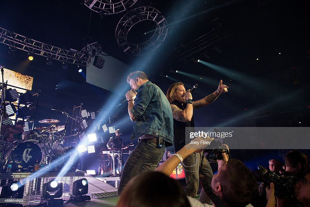 Brian Kelley and <a gi-track='captionPersonalityLinkClicked' href=/galleries/search?phrase=Tyler+Hubbard&family=editorial&specificpeople=9453787 ng-click='$event.stopPropagation()'>Tyler Hubbard</a> of Florida Georgia Line perform live onstage at Bankers Life Fieldhouse on February 15, 2014 in Indianapolis, Indiana.