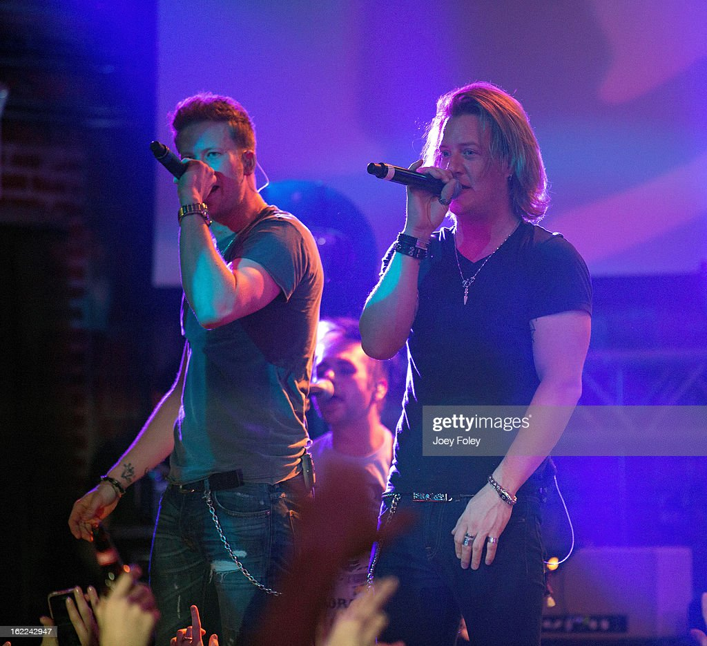 Brian Kelley and Tyler Hubbard of Florida Georgia Line performs in front of a sold-out crowd at Brick Street Bar on February 20, 2013 in Oxford, Ohio.