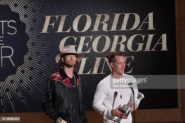 Brian Kelley and Tyler Hubbard of Florida Georgia Line recieve an award on stage during CMT Artists of the Year 2016 on October 19 2016 in Nashville...