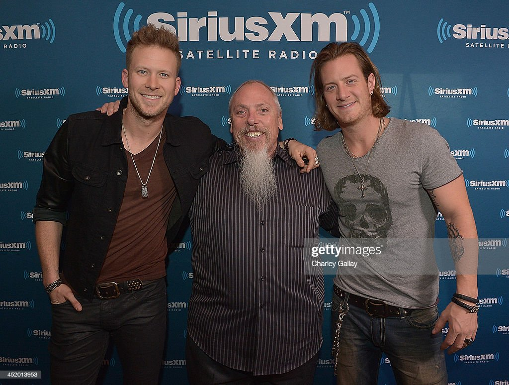 Brian Kelley and Tyler Hubbard of Florida Georgia Line with SiriusXM's John Marks are seen before performing a private concert for SiriusXM listeners...