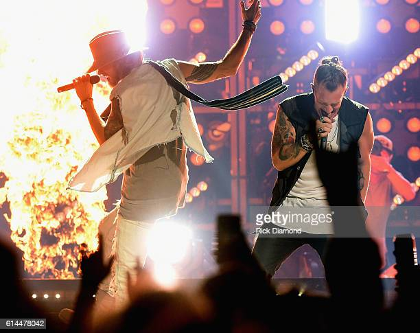 Brian Kelly and Tyler Hubbard of Florida Georgia Line perform during their Dig Your Roots 2016 Tour at Bridgestone Arena on October 13 2016 in...