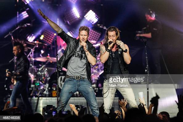 Brian Kelly and Tyler Hubbard of Florida Georgia Line perform live at Canadian Tire Centre on February 9 2014 in Kanata Canada