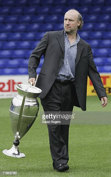 Brian Kennedy the owner of Sale Sharks carries the Guinness Premiership Trophy which his side won last season during the Sale Sharks media day held...