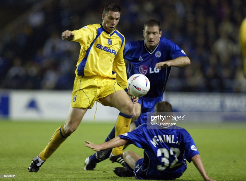 Brian Kerr of Coventry City is tackled by Gerry Taggart of Leicester City in front of a floored Billy McKinlay during the Nationwide First Division match between Leicester City and Coventry City at The Walkers Stadium, on October 29, 2002 in Leicester, England. (Photo by Mark Thompson/Getty Images).