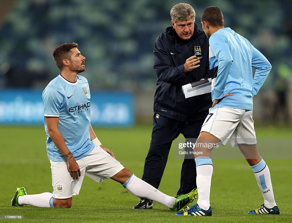 Brian Kidd of Manchester City talking to Javi Garcia and Jack Rodwell of Manchester City during the Nelson Mandela Football Invitational match between AmaZulu and Manchester City at Moses Mabhida Stadium on July 18, 2013 in Durban, South Africa.