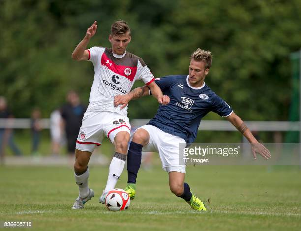 Brian Koglin of St Pauli and Alexander Luettmers of Oldenburg battle for the ball during the preseason friendly match between VfB Oldenburg and FC St...