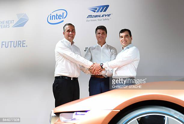 Brian Krzanich CEO of Intel Harald Krueger CEO of German car maker BMW and Amnon Shashua cofounder chairman and CTO Mobileye NV pose after a press...