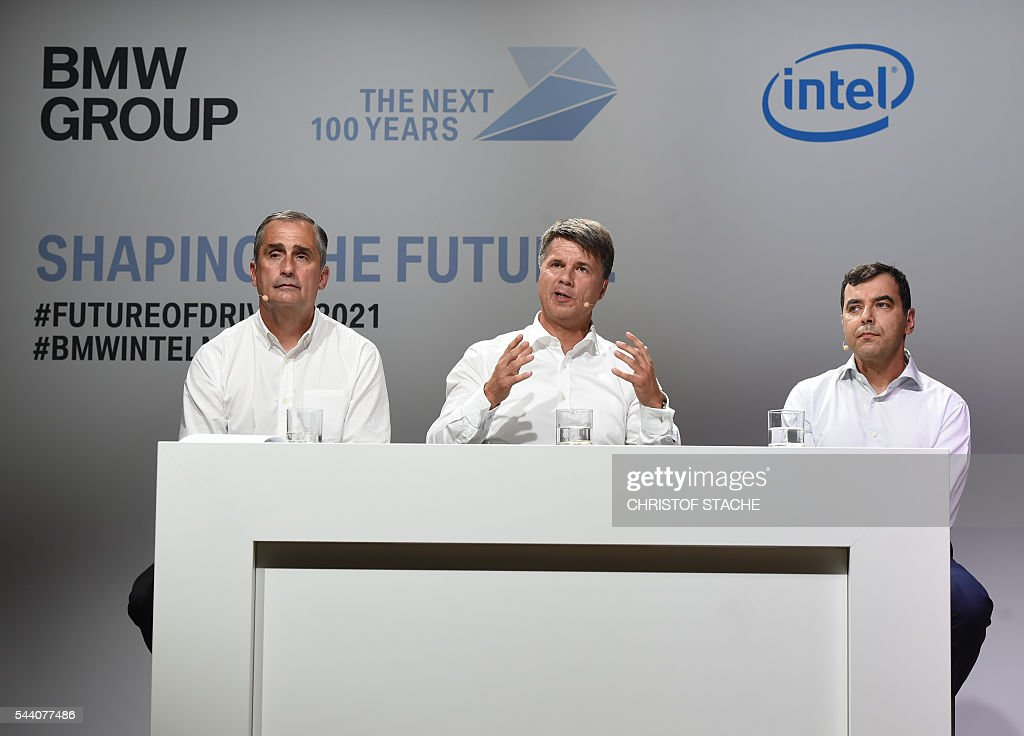 Brian Krzanich, CEO of Intel, Harald Krueger, CEO of German car maker BMW and Amnon Shashua, co-founder, chairman and CTO Mobileye NV, pose after a press conference in Munich, southern Germany, on July 1, 2016. The BMW Group, Intel and Mobileye, the three leaders from automotive, technology and computer vision and machine learning industries are collaborating to bring solutions for highly and fully automated driving into series production by 2021. / AFP / CHRISTOF