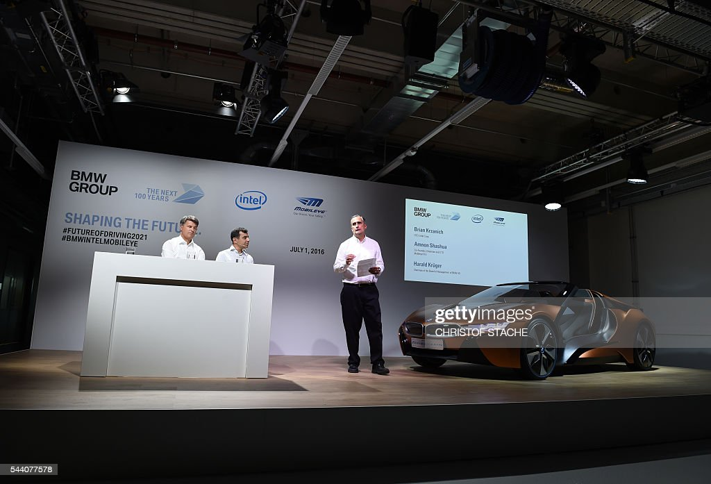 Brian Krzanich, CEO of Intel speaks beside Amnon Shashua, co-founder, chairman and CTO of Mobileye NV and Harald Krueger, CEO of German car maker BMW during a press conference in Munich, southern Germany, on July 1, 2016. The BMW Group, Intel and Mobileye, the three leaders from automotive, technology and computer vision and machine learning industries are collaborating to bring solutions for highly and fully automated driving into series production by 2021. / AFP / CHRISTOF