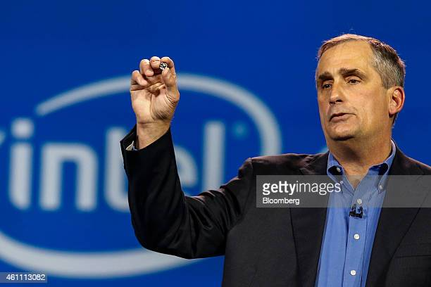 Brian Krzanich chief executive officer of Intel Corp holds a Curie wearable computer module after unveiling it during the 2015 Consumer Electronics...