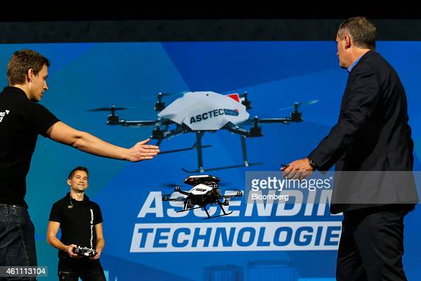 Brian Krzanich chief executive officer of Intel Corp right shows the collision avoidance feature of an AscTec Firefly drone with Intel RealSense...
