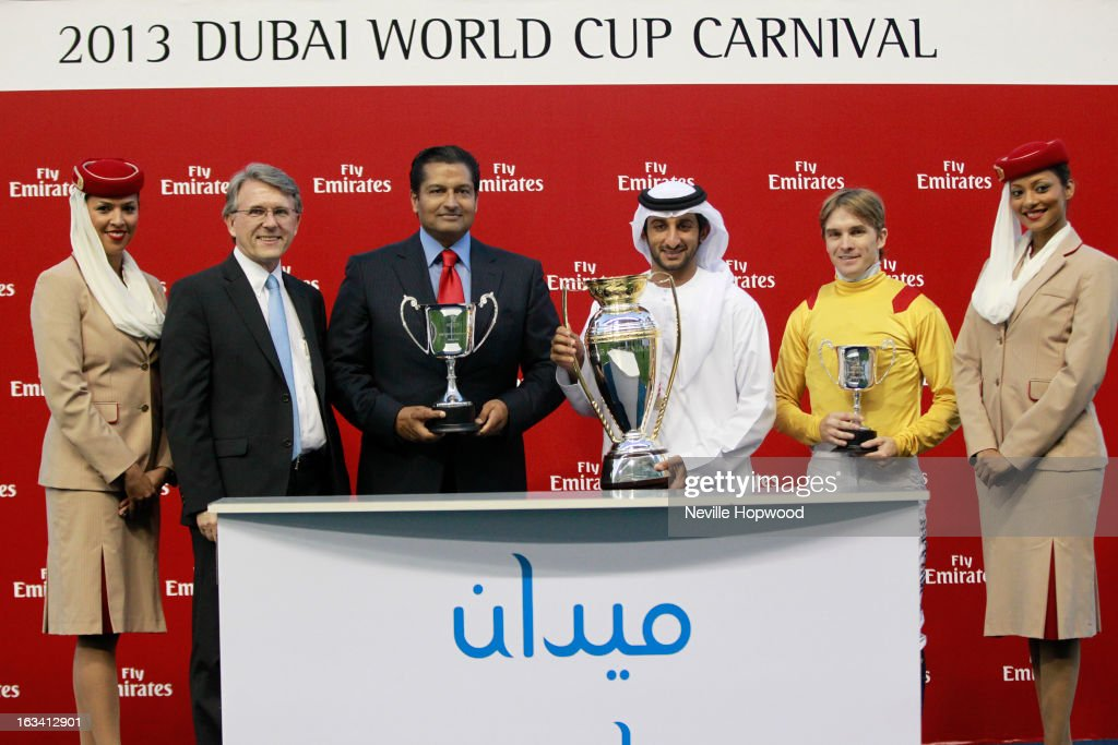 Brian LaBelle, Senior Vice President of Emirates Skywards, Trainer Satish Seemar, Sheikh Juma Al Maktoum and Jockey Richard Mullen attend the Reynaldothewizard presentation for winning the Mahab Al Shimaal race during Super Saturday at Meydan Racecourse on March 9, 2013 in Dubai, United Arab Emirates.