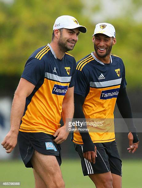 Brian Lake and Josh Gibson of the Hawks share a laugh during a Hawthorn Hawks AFL training session at Waverley Park on March 6 2015 in Melbourne...