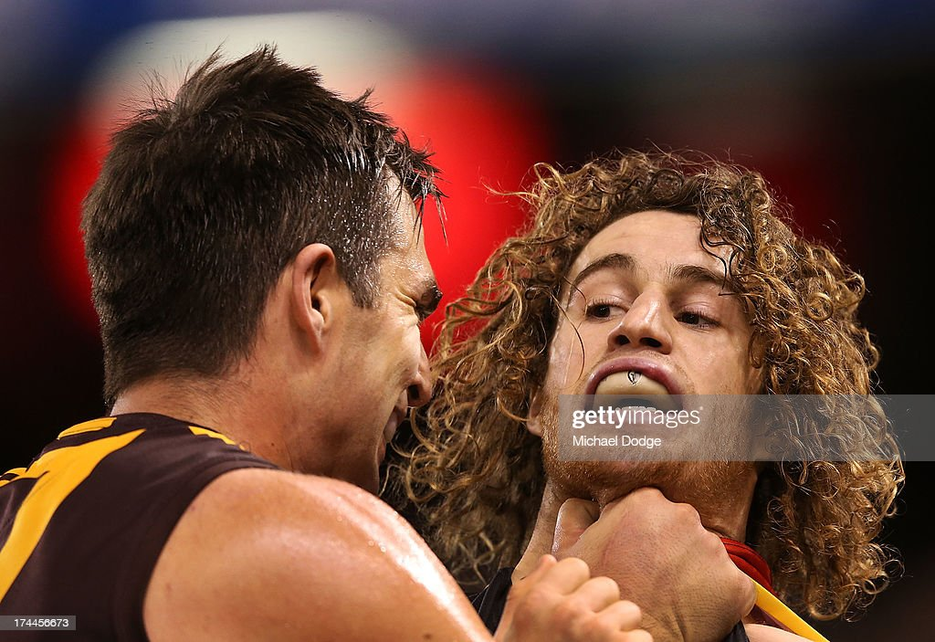 Brian Lake of the Hawks chokes Nick Kommer (R) of the Bombers behind play during the round 18 AFL match between the Essendon Bombers and the Hawthorn Hawks at Etihad Stadium on July 26, 2013 in Melbourne, Australia.
