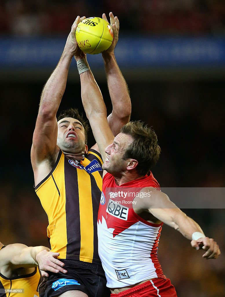 Brian Lake of the Hawks marks infront of Jude Bolton of the Swans during the AFL First Qualifying Final match between the Hawthorn Hawks and the Sydney Swans at the Melbourne Cricket Ground on September 6, 2013 in Melbourne, Australia.