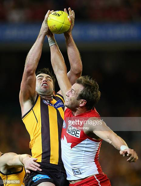 Brian Lake of the Hawks marks infront of Jude Bolton of the Swans during the AFL First Qualifying Final match between the Hawthorn Hawks and the...