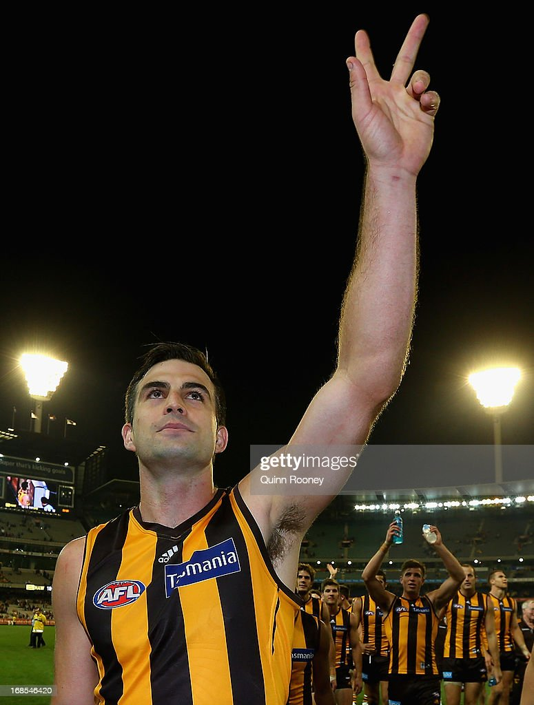 Brian Lake of the Hawks waves to the crowd after playing his 200th game during the round seven AFL match between the Hawthorn Hawks and the Sydney Swans at Melbourne Cricket Ground on May 11, 2013 in Melbourne, Australia.