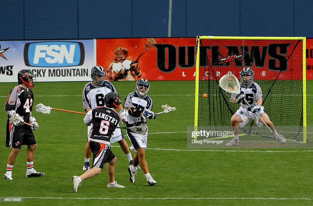 Brian Langtry of the Denver Outlaws follows through on his shot as he scores a first period goal on goalie Chris Garrity of the Washington Bayhawks...