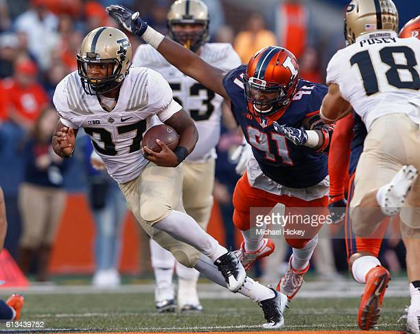 Brian LankfordJohnson of the Purdue Boilermakers runs the ball as Dawuane Smoot of the Illinois Fighting Illini comes from behind to attempt the...