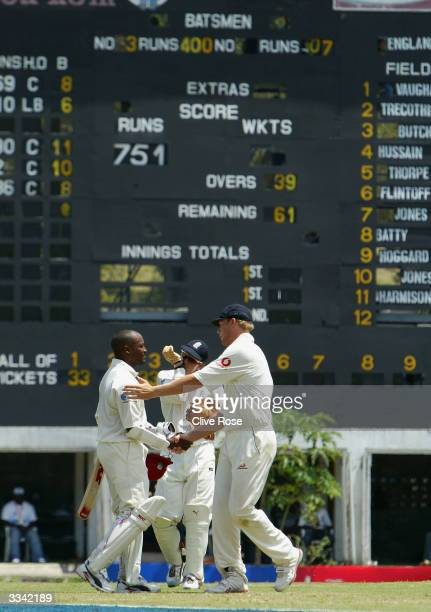 Brian Lara is congratulated by Andrew Flintoff after achieving 400 runs during day three of the fourth Test match between the West Indies and England...