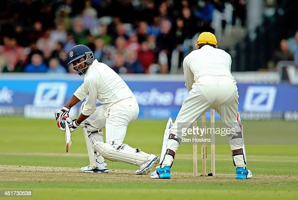 Brian Lara of Rest of the World hits out past Adam Gilchrist during the MCC and Rest of the World match at Lord's Cricket Ground on July 5 2014 in...