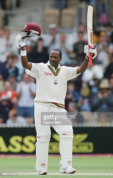 Brian Lara of the West Indies celebrates after scoring his record 11175th career Test run to become the most prolific scorer in Test history...