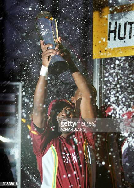 Brian Lara of The West Indies holds aloft The ICC Champions Trophy after his team beat England in the final at The Oval in London 25 September 2004...