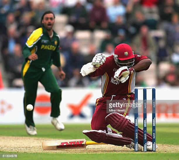 Brian Lara of West Indies is felled by a bouncer from Shoaib Akhtar of Pakistan during the semifinal of the ICC Champions Trophy between Pakistan and...