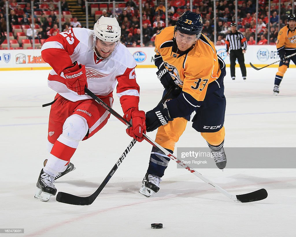 Brian Lashoff #23 of the Detroit Red Wings battles for the puck with Colin Wilson #33 of the Nashville Predators during a NHL game at Joe Louis Arena on February 23, 2013 in Detroit, Michigan. The Wings won 4-0