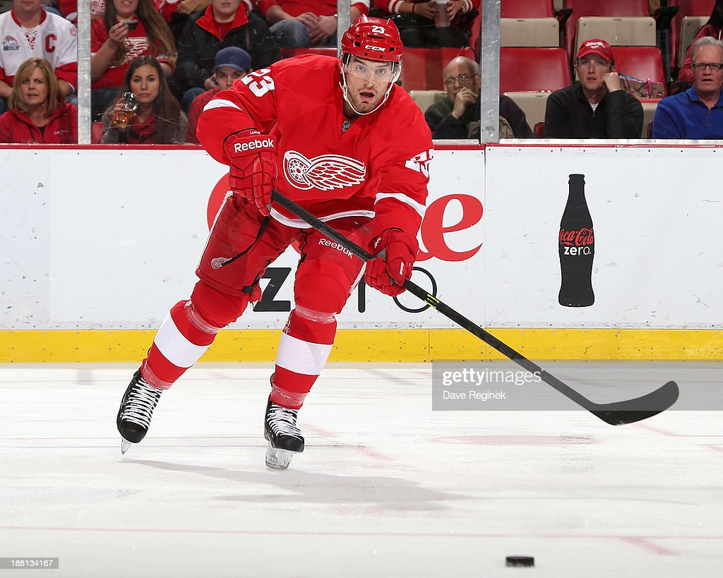 Brian Lashoff #23 of the Detroit Red Wings passes the puck during an NHL game against the Washington Capitals at Joe Louis Arena on November 15, 2013 in Detroit, Michigan.