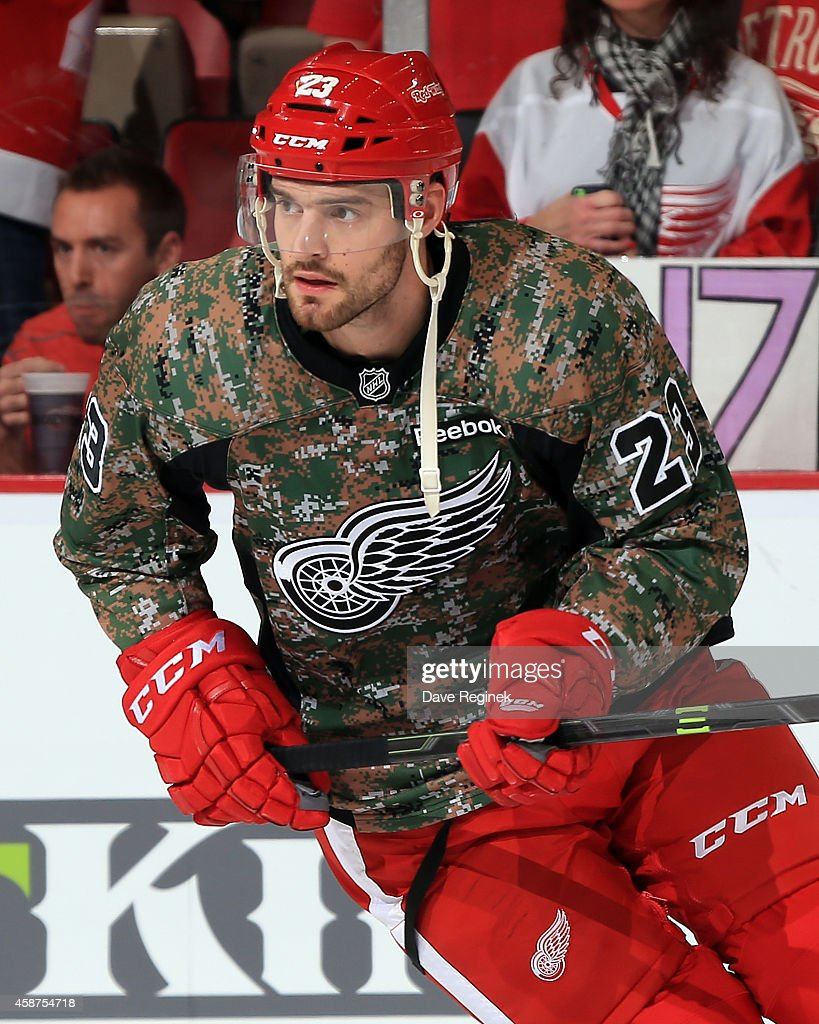 <a gi-track='captionPersonalityLinkClicked' href=/galleries/search?phrase=Brian+Lashoff&family=editorial&specificpeople=5529056 ng-click='$event.stopPropagation()'>Brian Lashoff</a> #23 of the Detroit Red Wings skates around in warm-ups while wearing his 'Camo' jersey in honor of the servicemen and women as part of Military Appreciation Night before a NHL game against the New Jersey Devils on November 7, 2014 at Joe Louis Arena in Detroit, Michigan. The Red Wings defeated the Devils 4-2.