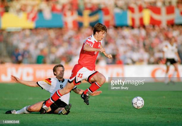 Brian Laudrup of Denmark takes the ball past Guido Buchwald of Germany during the UEFA European Championships 1992 Final between Denmark and Germany...