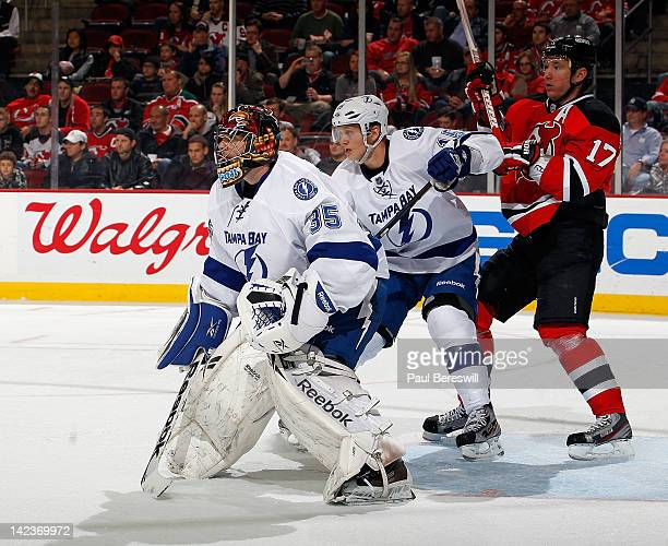 Brian Lee and goalie Sebastien Caron of the Tampa Bay Lightning try to protect the goal from Ilya Kovalchuk of the New Jersey Devils during an NHL...