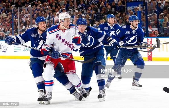 Brian Lee and Ryan Malone of the Tampa Bay Lightning check Matt Gilroy of the New York Rangers during the second period of their game at the Tampa...