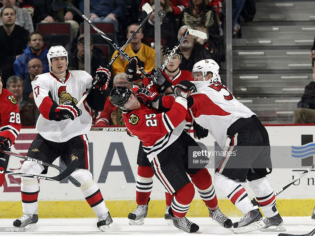 Brian Lee #5 of the Ottawa Senators pushes into <a gi-track='captionPersonalityLinkClicked' href=/galleries/search?phrase=Viktor+Stalberg&family=editorial&specificpeople=5802237 ng-click='$event.stopPropagation()'>Viktor Stalberg</a> #25 of the Chicago Blackhawks as teammate <a gi-track='captionPersonalityLinkClicked' href=/galleries/search?phrase=Filip+Kuba&family=editorial&specificpeople=209425 ng-click='$event.stopPropagation()'>Filip Kuba</a> #17 watches from behind on January 7, 2011 at the United Center in Chicago, Illinois.