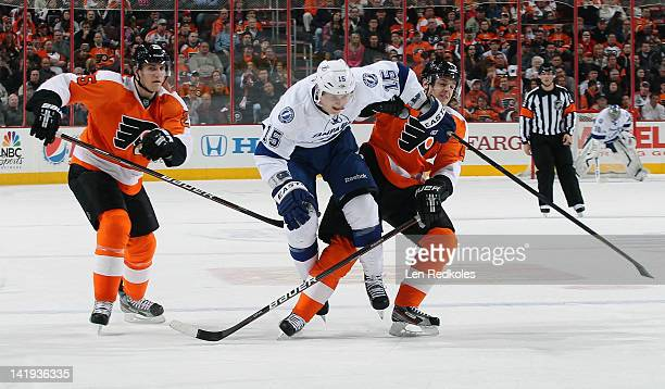 Brian Lee of the Tampa Bay Lightning breaks through the defense of Matt Carle and Danny Briere of the Philadelphia Flyers on March 26 2012 at the...