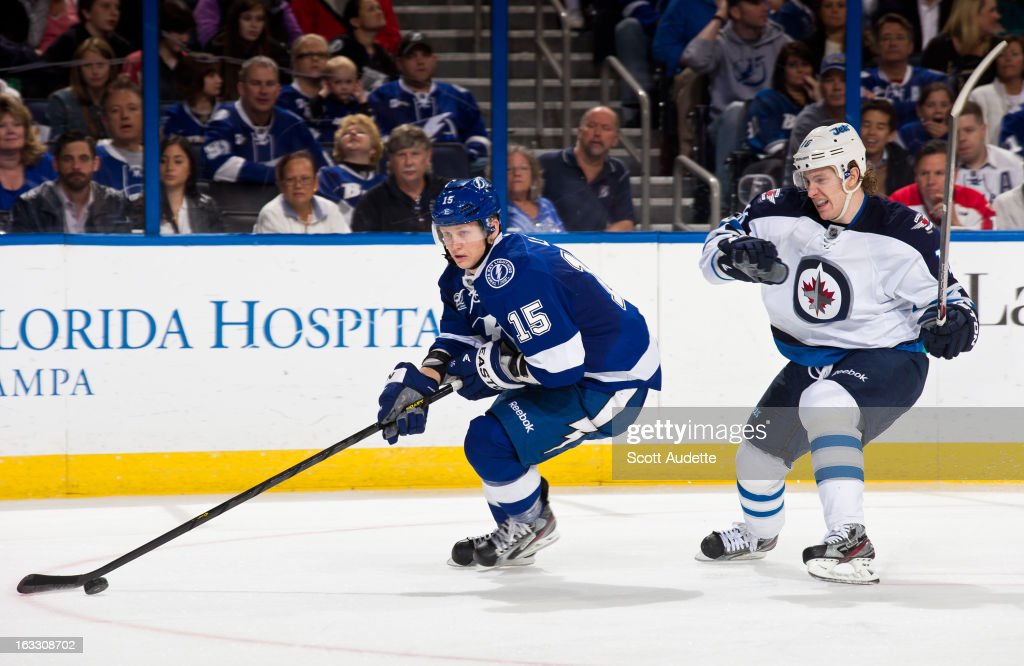 Brian Lee #15 of the Tampa Bay Lightning controls the puck in front of <a gi-track='captionPersonalityLinkClicked' href=/galleries/search?phrase=Andrew+Ladd&family=editorial&specificpeople=228452 ng-click='$event.stopPropagation()'>Andrew Ladd</a> #16 of the Winnipeg Jets during the second period of the game at the Tampa Bay Times Forum on March 7, 2013 in Tampa, Florida.