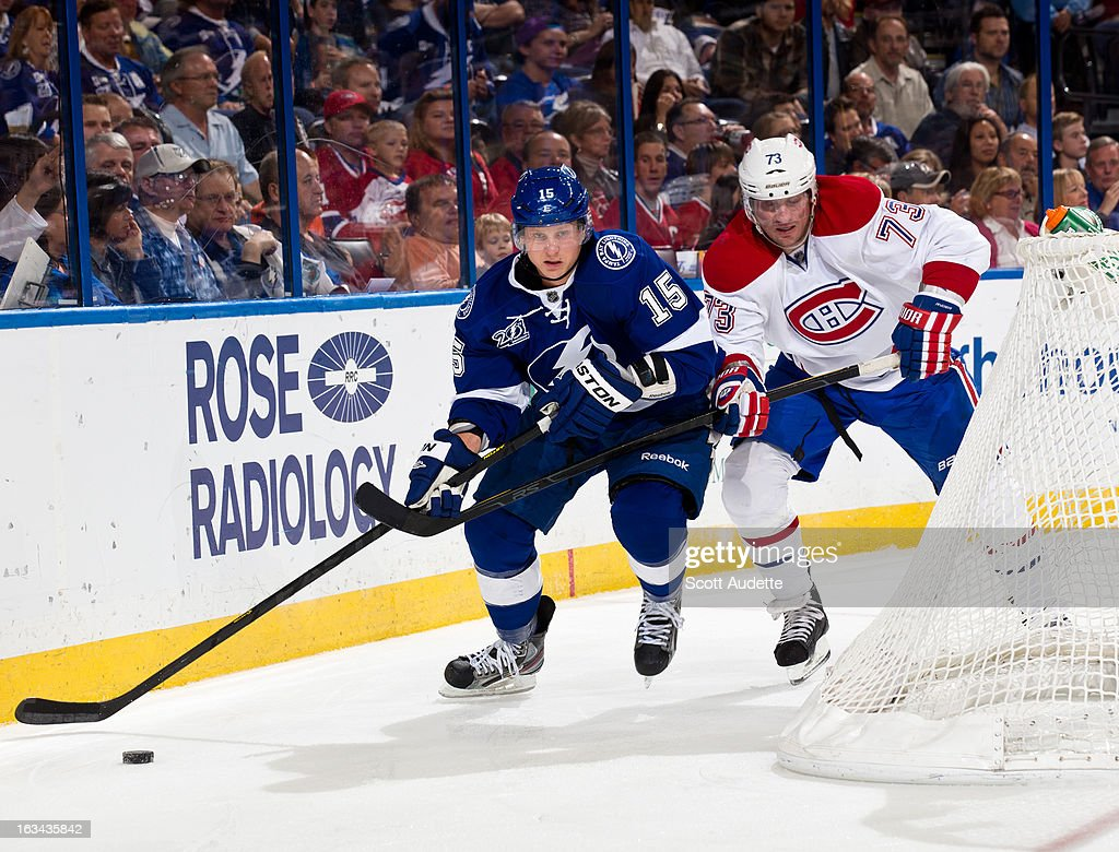 Brian Lee #15 of the Tampa Bay Lightning controls the puck in front of <a gi-track='captionPersonalityLinkClicked' href=/galleries/search?phrase=Michael+Ryder&family=editorial&specificpeople=208983 ng-click='$event.stopPropagation()'>Michael Ryder</a> #73 of the Montreal Canadiens during the second period of the game at the Tampa Bay Times Forum on March 9, 2013 in Tampa, Florida.