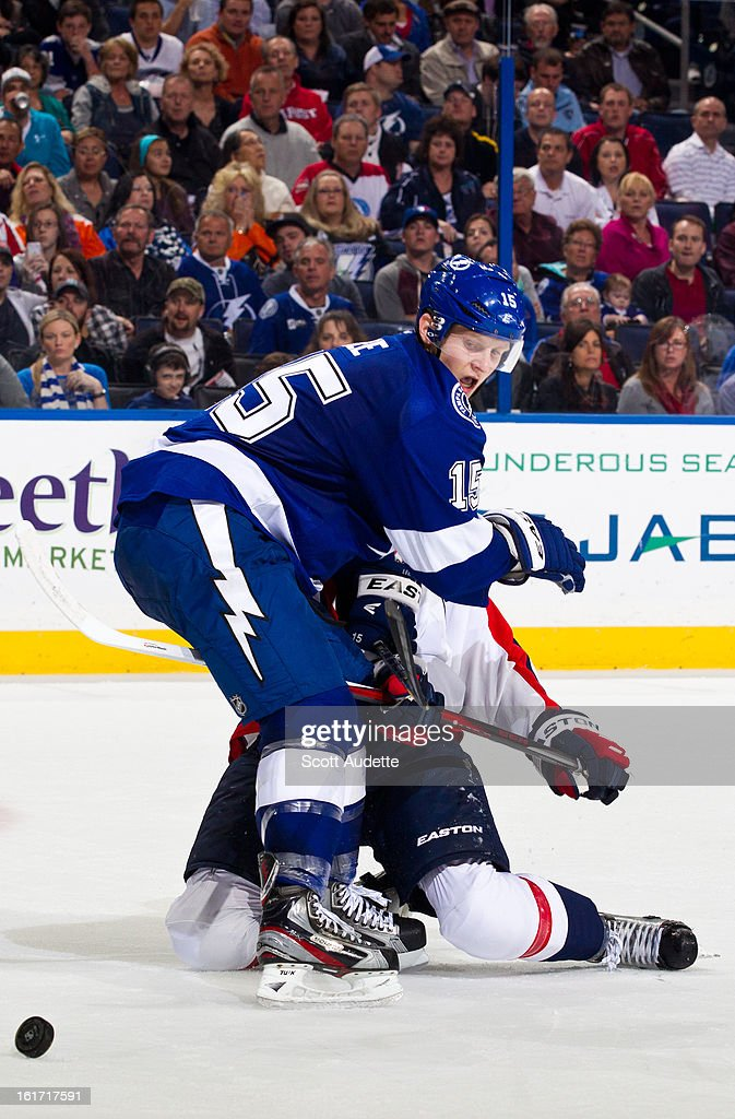 Brian Lee #15 of the Tampa Bay Lightning fights for position against the Washington Capitals player during the second period of the game at the Tampa Bay Times Forum on February 14, 2013 in Tampa, Florida.