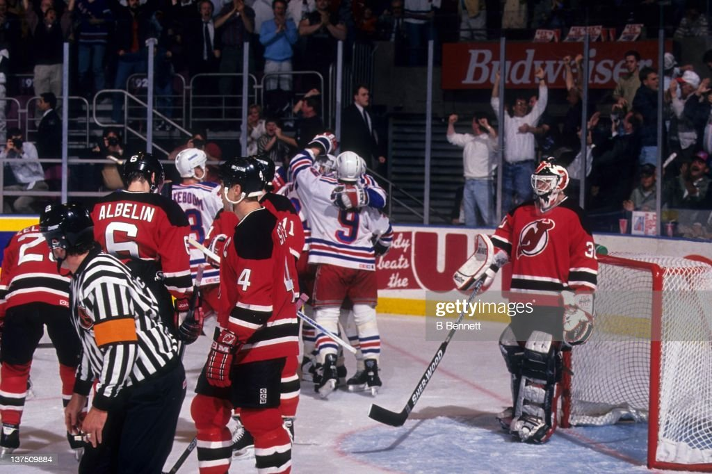 Brian Leetch of the New York Rangers celebrates with teammates after scoring the first goal in the second period of Game 7 of the 1994 Eastern...