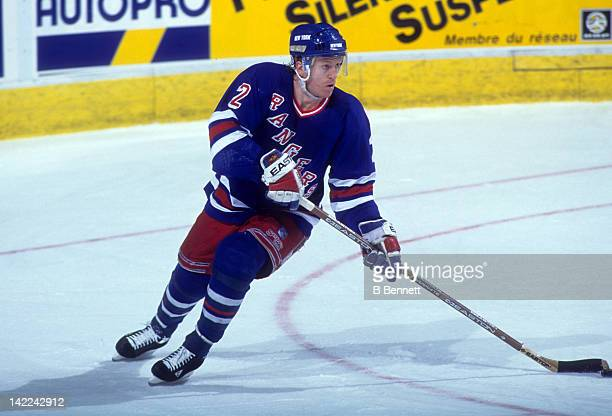 Brian Leetch of the New York Rangers skates with the puck during Game 1 of the 1995 Conference Quarter Finals against the Quebec Nordiques on May 6...