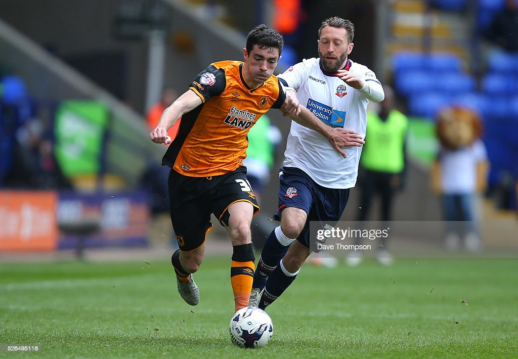 Brian Lenihan of Hull City and Stephen Dobbie of Bolton Wanderers compete for the ball during the Sky Bet Championship match between Bolton Wanderers and Hull City at the Macron Stadium on April 30, 2016 in Bolton, United Kingdom.